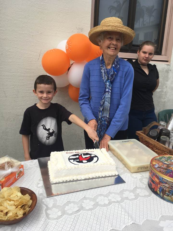 St James Celebration 40 years since Union - youngest and the oldest cudtting the cake